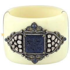 Carved Sapphire Bakelite Cuff with Diamond Motif