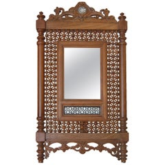 Carved Teak Mirror with Mother of Pearl