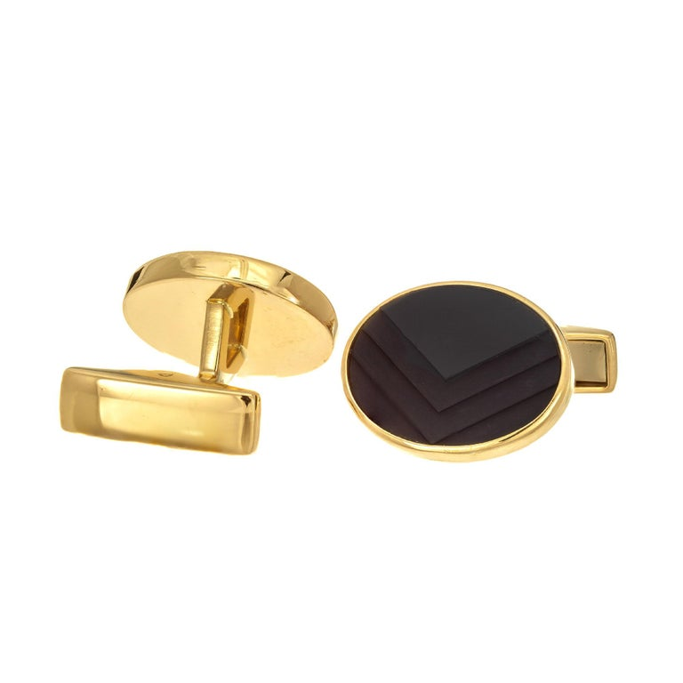 German carved chevron design textured 18k yellow gold cufflinks.  2 oval black chevron cut onyx 18k yellow gold  Stamped: 18k Germany 13.8 grams  Top to bottom: 14.5mm or 9/16 Inch Width: 17.9mm or 5/8 Inch Depth or thickness: 3.46mm