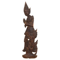 Carved Thai Wooden Sculpture of a Praying Apsara with Dark Brown Patina