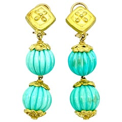 Carved Turquoise Bead and 18 Karat Yellow Gold Dangle Earrings