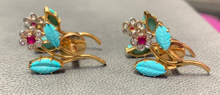 Multi Gem Floral Cufflinks 8 carved leaf design turquoise  24 round cut diamonds  4 round cut rubies  Measurements: 1