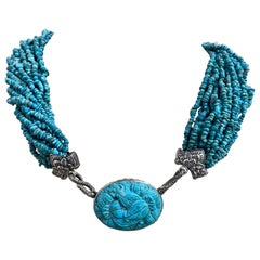 Carved Turquoise Pendant with multi-strand Turquoise Beads in a Sterling Silver