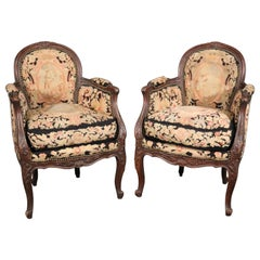 Carved Walnut and Needlepoint Upholstered French Louis XVI Bergère Chairs C1920s