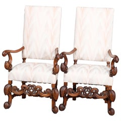 Carved Walnut Continental Baroque Upholstered Tall Fireside Chairs, circa 1910