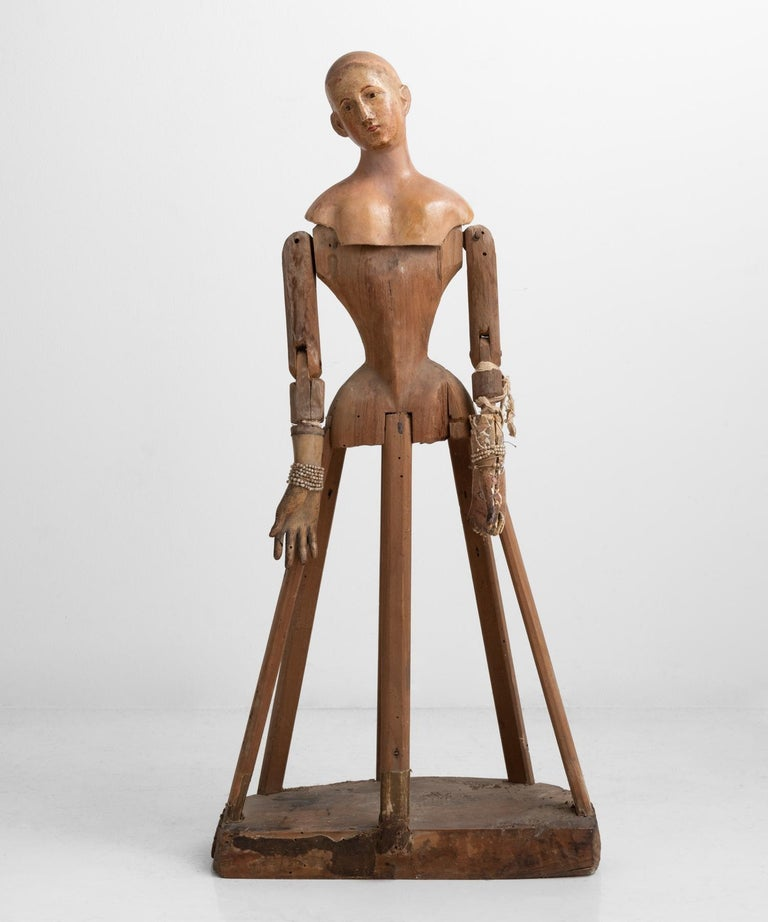 Carved wood and paper Mache Santos figure, Italy circa 1870  Primitive form with hand painted detailing and miniature rosary beads.