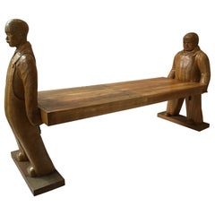 Carved Wood Bench or Table of Two Workers Moving a Piece of Wood