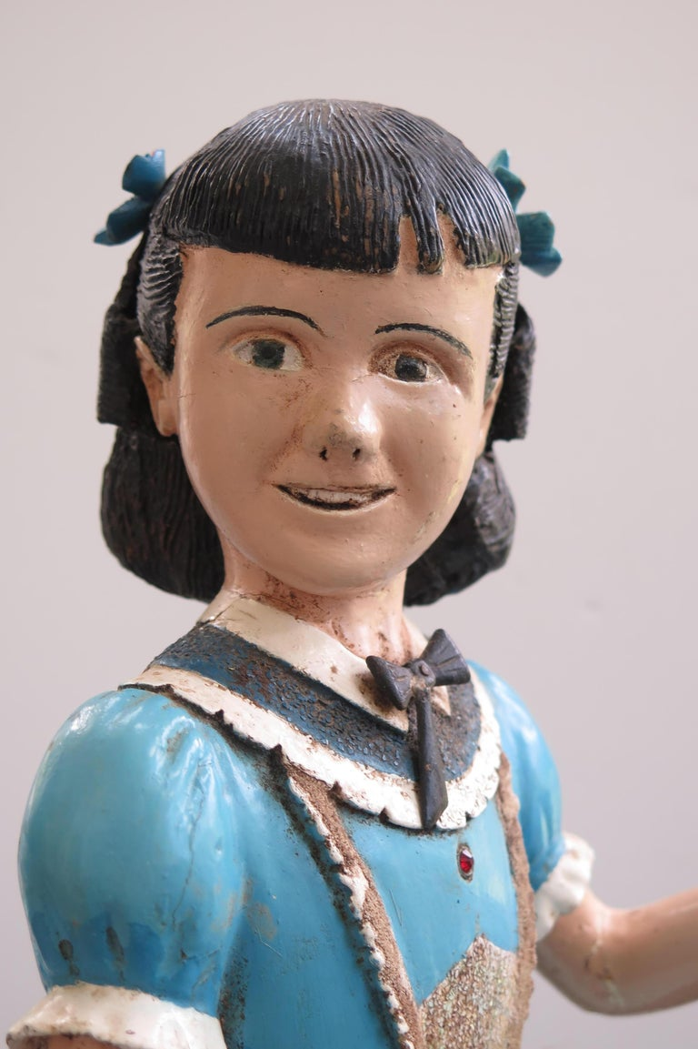 Harold Ibach and his wife were not able to have children but Harold could carve so he made an imaginary daughter he called Kitty. Kitty was carved and pieced of wood and meticulously painted. The turned head animated the girl and he added bows to