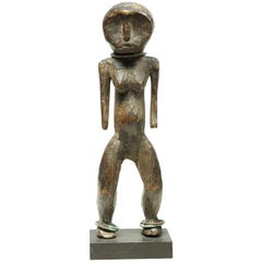 Carved Wood Tribal Ngaka Figure from Northern Zaire, with Copper Rings