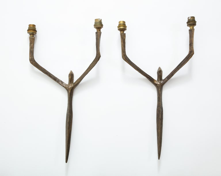 Pair of patinated bronze male caryatides sconces by Felix Agostini, France, 1960.