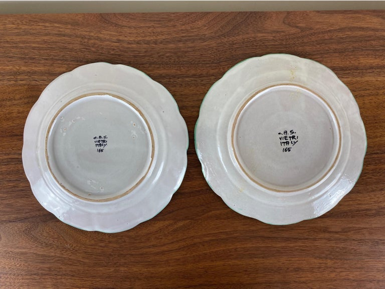 Colorful pair of Mid-Century Modern ceramic plates from Italy.    Signed CAS Vietri.