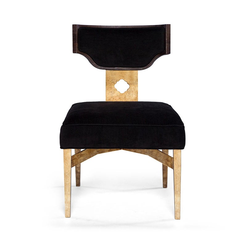 Complementary to the Casablanca desk, the sophisticated Casablanca desk chair makes a bold statement. This chair features a metal back support with a decorative opening, a shaped wooden back frame, and hand-gilded metal legs. The upholstered seat
