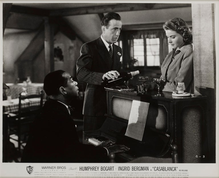 Original US black and white photographic production still used for the 1960 re-release of the film in America. The film staring Humphrey Bogart, Ingrid Bergman and Paul Henreid. The film remains one of the most famous of all time. The piece is