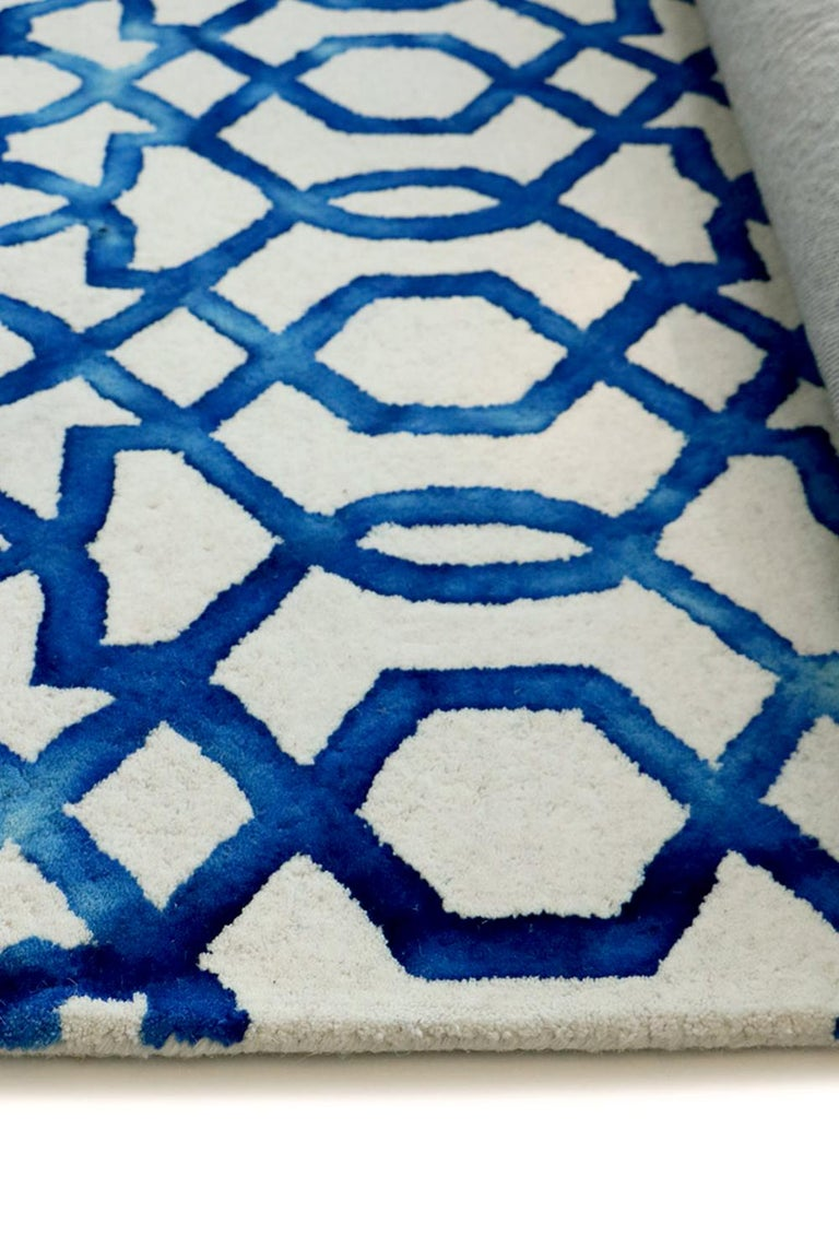 Casablanca by Italian contemporary rug company G.T.DESIGN is created through an updated tie and dye technique and produced in high quality New Zealand wool.  The pattern or interlocking geometrical shapes, designed by G.T.DESIGN's creative Director