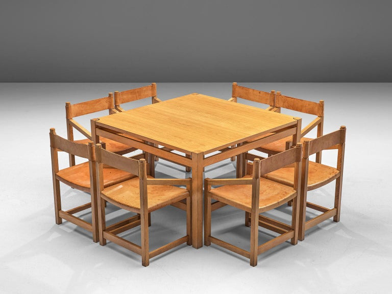 Casablanca Jordi Muntañola, dining set with table and 8 armchairs, pine and leather, Spain, 1979.  This set of eight armchairs from Spain is purist and modest. The chairs feature an architectural frame, of which the combination with diagonal