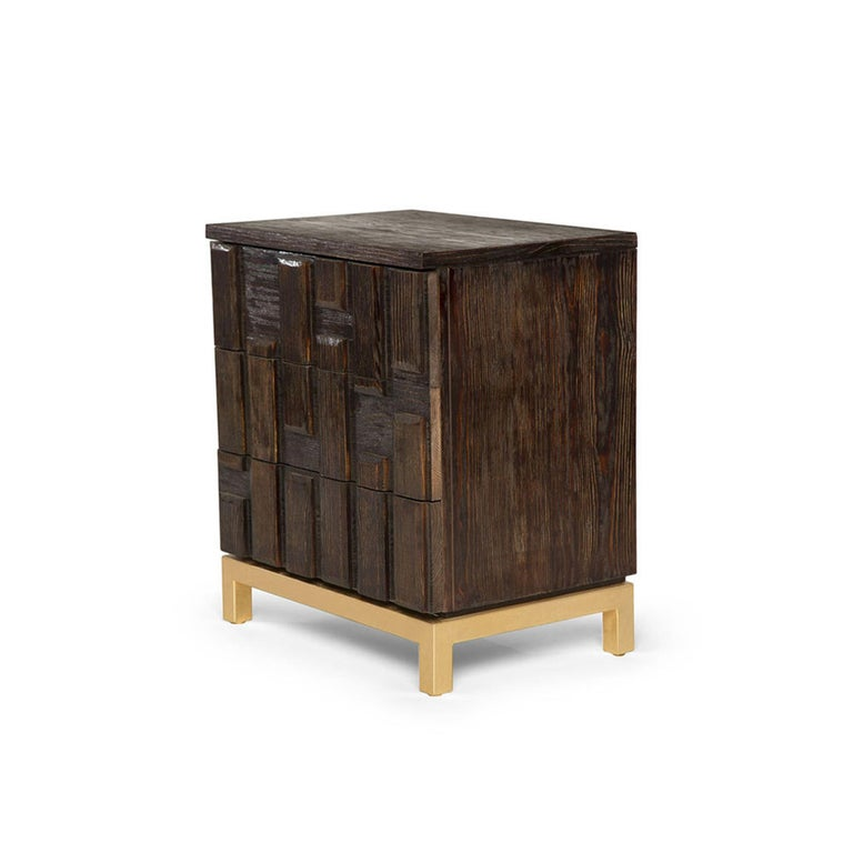 The Casablanca nightstand has been ornately assembled with individually-placed reclaimed beveled wood panels that are hand-painted to perfection. This unique, three-drawer nightstand sits on a hand-gilded gold leafed metal base. Its sleek lines give