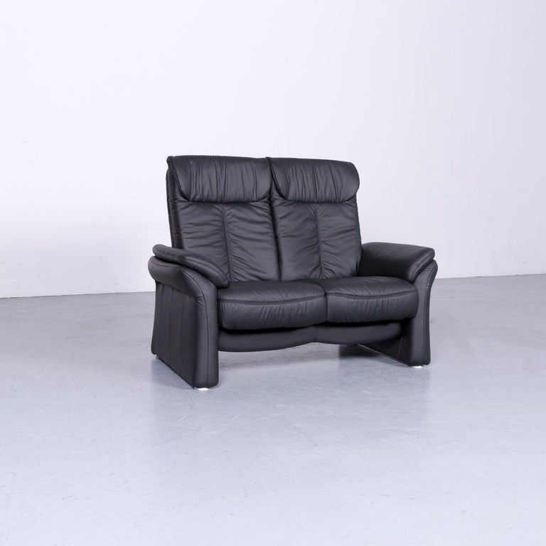 We bring to you an Casada designer leather sofa black two-seat couch recliner.