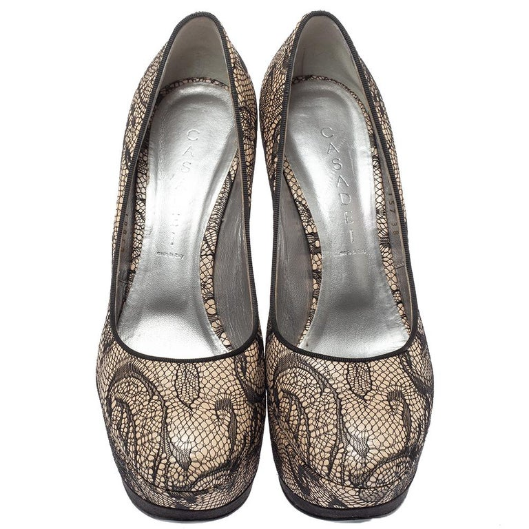 Perfect companions to your skirts and dresses, these Casadei pumps are totally worth buying! They come crafted from lace and satin in a round toe silhouette and styled with solid platforms and 14 cm heels. Comfortable leather-lined insoles ensure