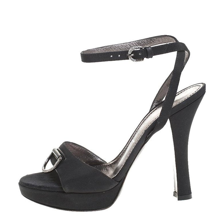 These chic sandals by Casadei are the most versatile pair you can possibly own. These grosgrain fabric sandals are fashionable and chic. These sandals feature platforms, crystal accents and 12 cm heels. Stay comfortable through your day in this