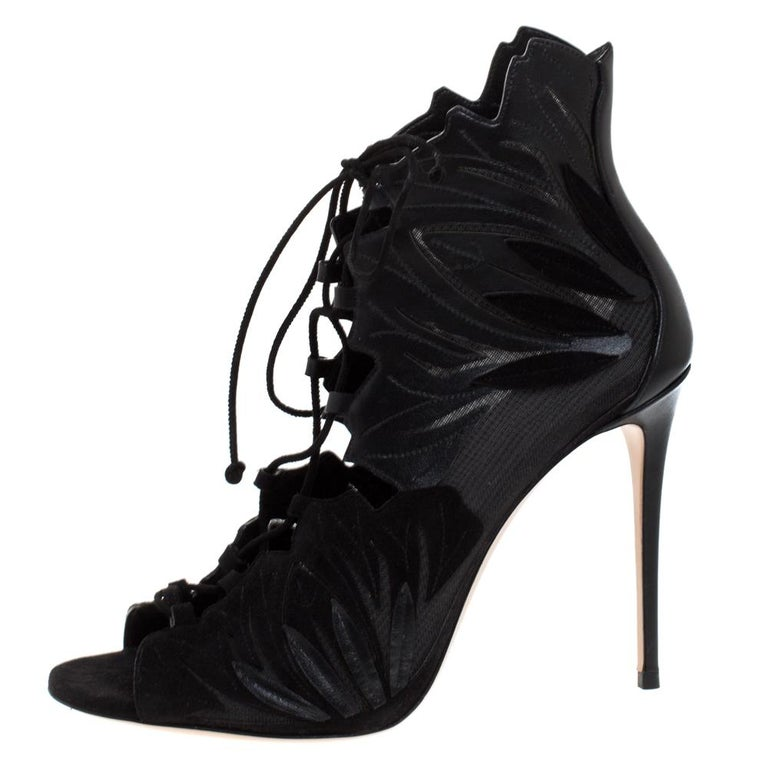 Glamorous, scintillating and very stylish, these booties from Casadei will make your heart skip a beat with their sheer brilliance! They have been crafted from a combination of leather, mesh and suede and feature a peep-toe silhouette. Flaunting an