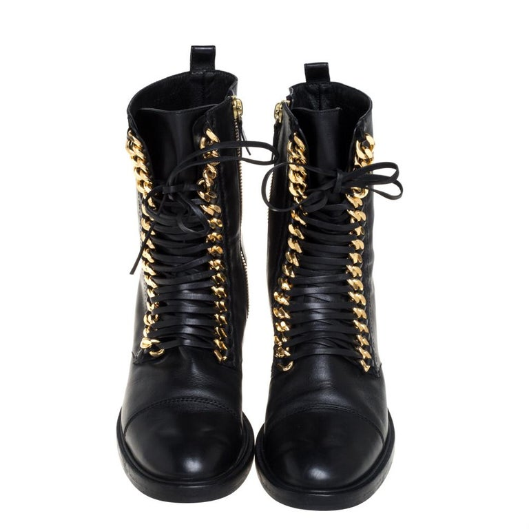 Casadei updates an ageless silhouette with an element of edge with their City Rock boots. Crafted from black leather, the ankle boots are adorned with gold-tone chunky chains along with slender laces. The boots are complete with round toes and