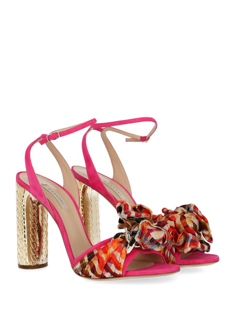 Shoe, leather, other patterns, engraved logo, suede, ankle strap, buckle fastening, gold-tone hardware, branded insole, high heel, contrasting heel, embellished heel, bow detail.  Includes: - Box - Dust bag  Product Condition: New With