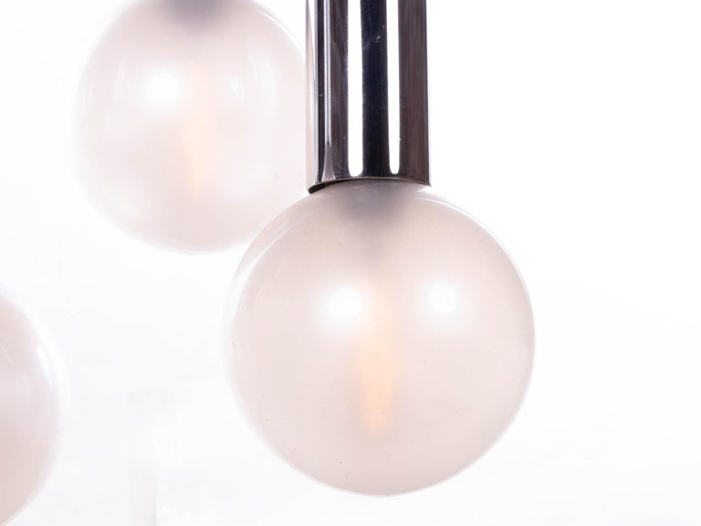 Elegant space age sputnik ceiling fixture with pearlized glass globes 'like bulbs' hanging on six chromed metal tubes. Chandelier illuminates beautifully and offers a lot of light. Designed by Motoko Ishii for Staff Lighting, Germany, 1970s.