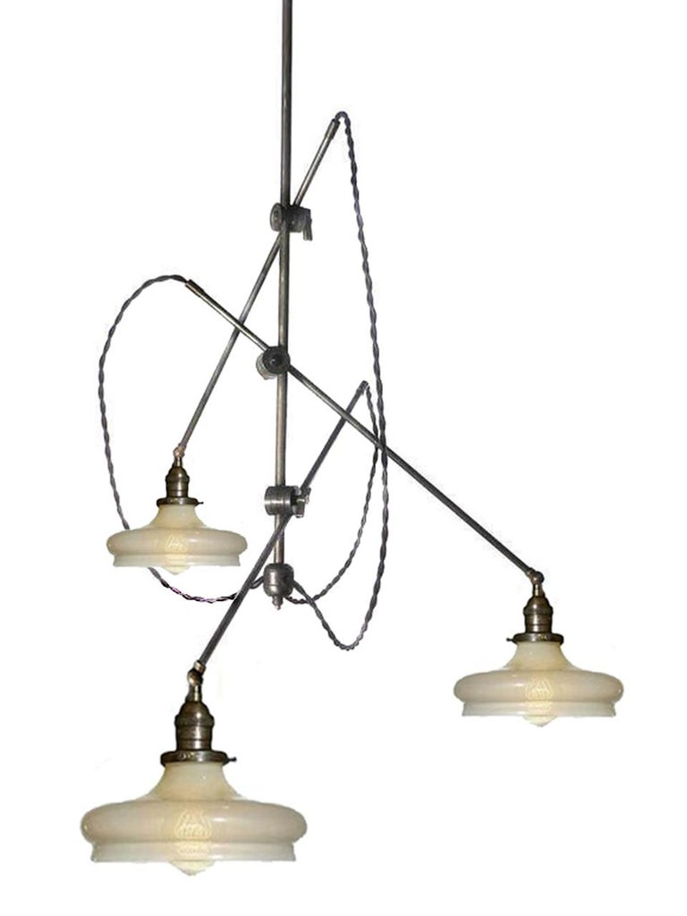 This perfectly sized articulated fixture features three matching Vaseline glass shades. The arms are all 36 inches long and the shades have 8.5 inch inch diameters. The vertical rod is 36 inches as well but can be longer if needed. The delicate