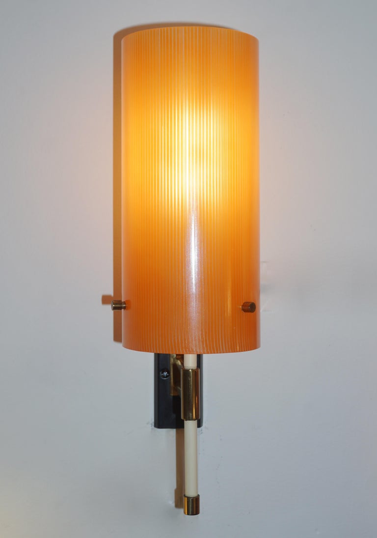 Rare Mid-Century Modern pair of glass sconces, entirely handcrafted in Italy by Casey Fantin, Florence, a wonderful example of Minimalist midcentury Italian design. High quality of manufacturing with slender cylindrical frosted glass shades (9.5 in.