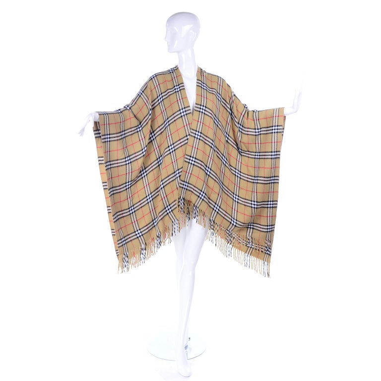 This is a fabulous vintage Burberry cashmere blend cape / poncho that is so easy to wear and so soft!  Not a classic poncho because the front is open, so we really call it more of a cape. The cape is similar to the modern Collette Cape, this has the