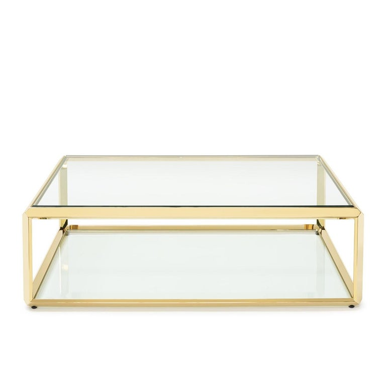 Coffee table casiopee with structure in gold finish, with beveled glass top up and down the coffee table.
