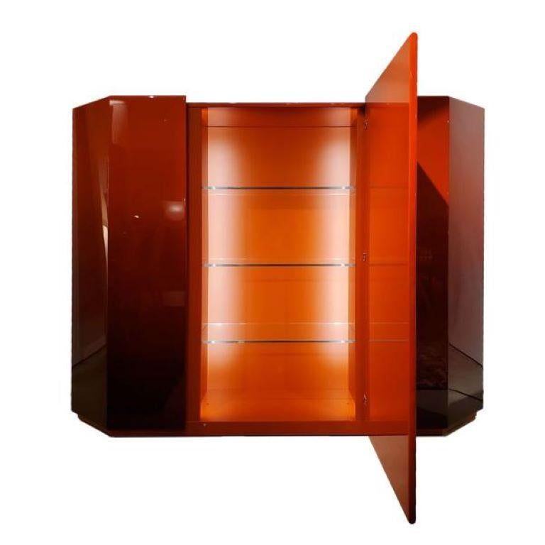 A design storage cabinet, symbol of a modern-day timeless classic with sleek uncluttered lines upon which the Japanese architect Takahama projects a deep relationship with the past, recalling the ancient art of lacquer finishes. This Cabinet is in