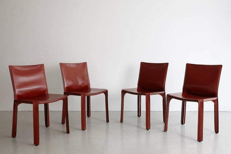 Classic leather cab chairs by Mario Bellini for Cassina. Great patina to leather. Excellent vintage condition. Set of four available. Priced individually.