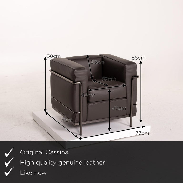 We present to you a Cassina Le Corbusier LC 2 leather armchair gray brown brown.       Product measurements in centimeters:    Depth 71 Width 77 Height 68 Seat height 47 Rest height 68 Seat depth 52 Seat width 42 Back height 23.