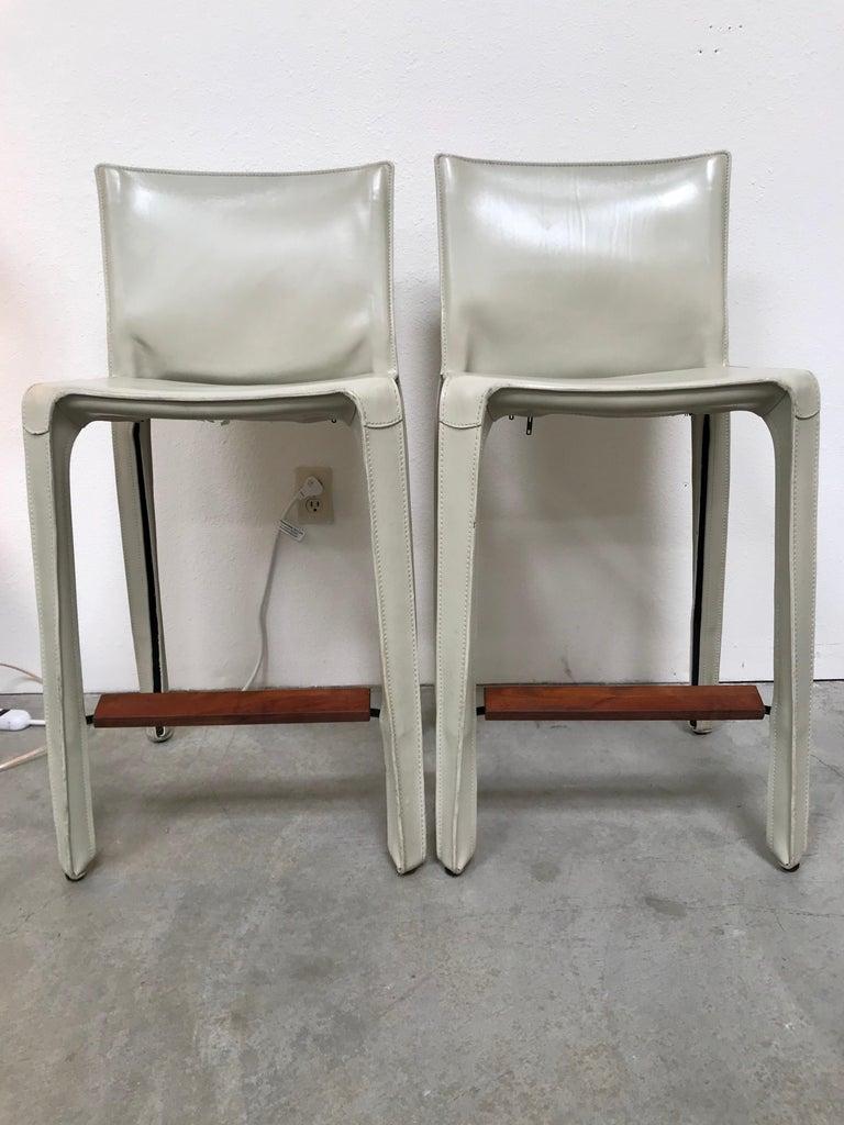 Limited production design with walnut footrest bone white saddle leather on steel frame.