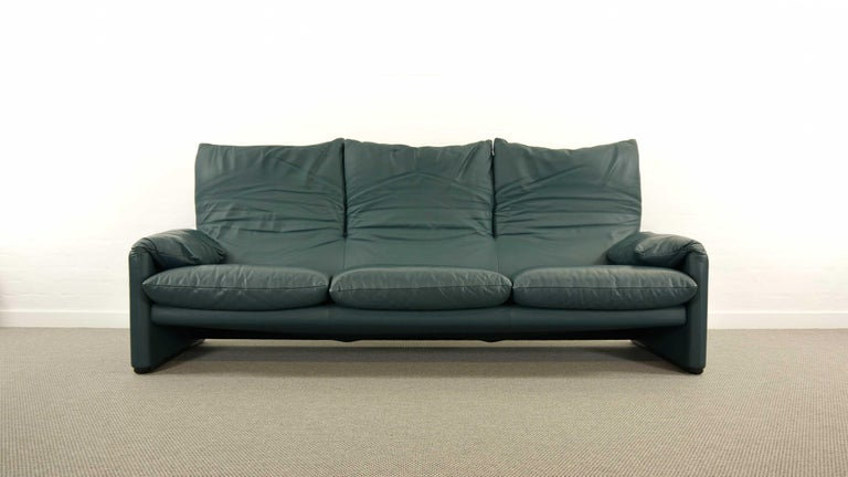 Maralunga 3-seat sofa by Vico Magistretti for Cassina, designed in 1973. Original upholstery in dark green / petrol leather. Color is really hard to capture, depends on the light. This sofa features folding back rests / cushions that can be folded