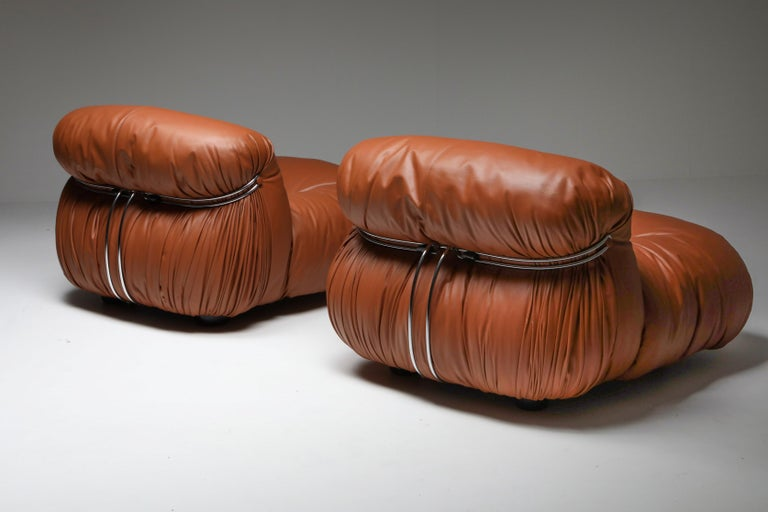 Afra and Tobia Scarpa, Soriana, original cognac leather, Cassina  Manufactured by Cassina in the 1970s, the Soriana collection was meant to express beauty and comfort by using a whole bundle of fabric held by a chrome-plated steel clamp. The