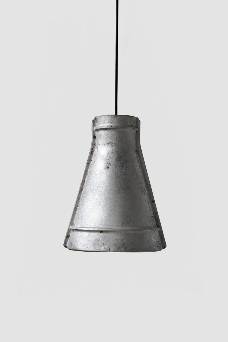 Material: Cast - aluminum Color: White Dimension: 240 x 440 x 330 mm Weight: 5 kg Cord: 2950 mm Light Source: LED E27 CCT: 3000 - 3500 K CRI: 80 - 90 Ra Flux: 230 lm Supply: 86 - 240 V Wattage: 3 W . Max 40 W  About the Artist/