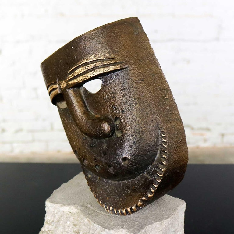Cast Bronze African Mask Sculpture with Crooked Nose Mounted on Limestone Stand For Sale 5
