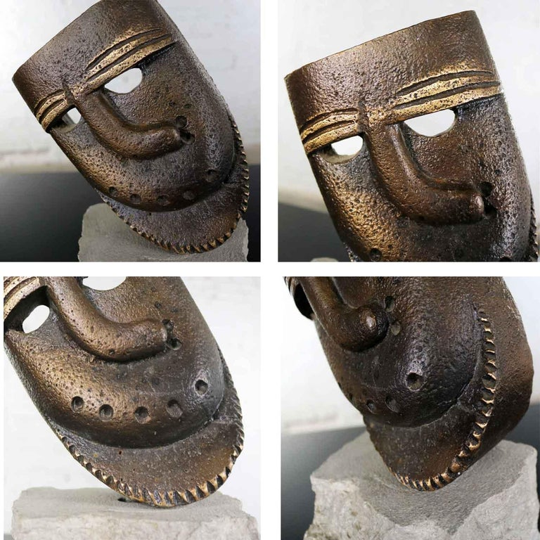 Cast Bronze African Mask Sculpture with Crooked Nose Mounted on Limestone Stand For Sale 6