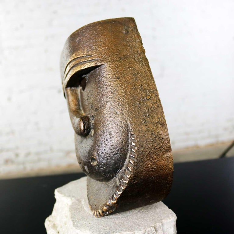 Cast Bronze African Mask Sculpture with Crooked Nose Mounted on Limestone Stand For Sale 4