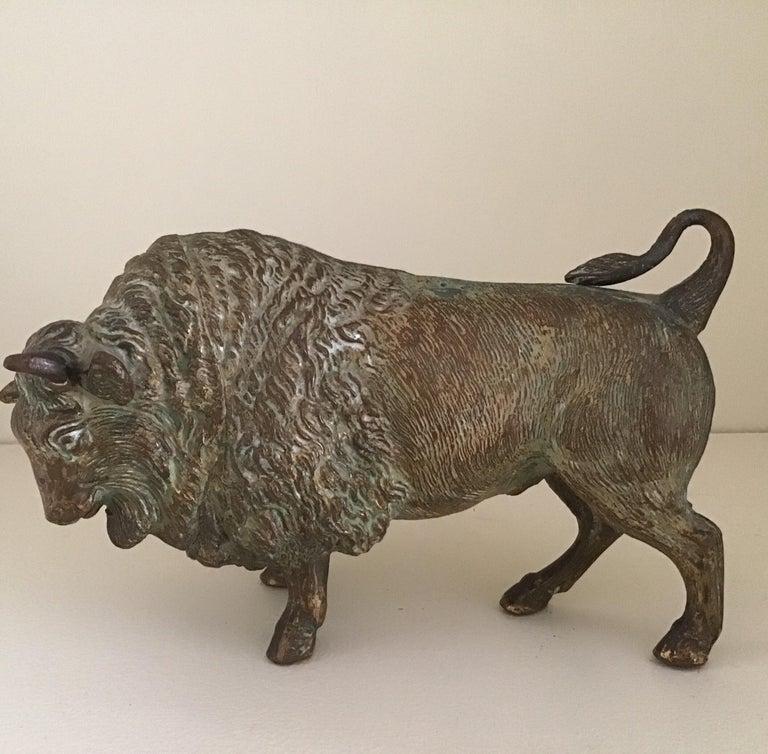 Cast bronze bull sculpture, circa 1890s.