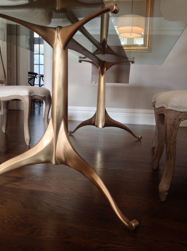 The Bronze age was one of three ages that demonstrated mankind's capacity for creativity and ingenuity. These custom cast bronze dining & pedestal table bases are made at a local Chicago foundry specializing in art castings.  The elegant tapered