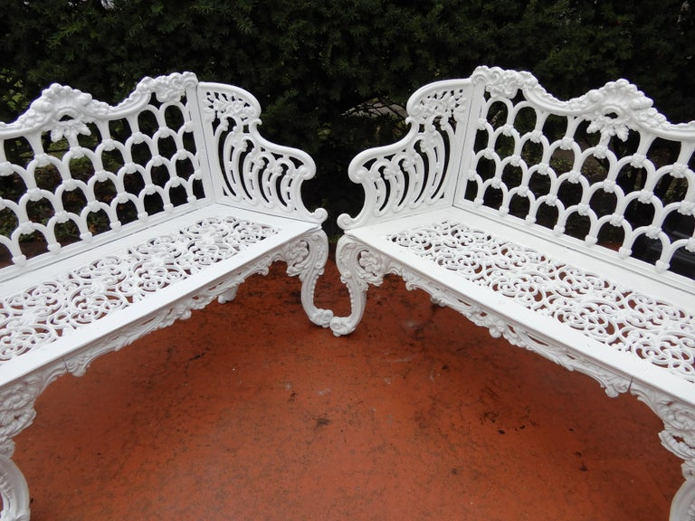 An assembled pair of late 19th century cast iron garden benches. This Gothic pattern bench is seen in the garden of the White House, and therefore has been referred to as the White House garden bench. The benches are of slighty different sizes which