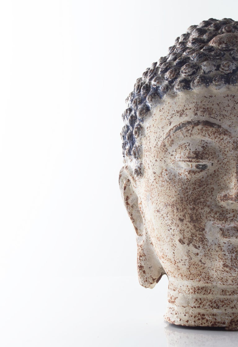 Cast iron bust of Budda in heavily distressed paint patina