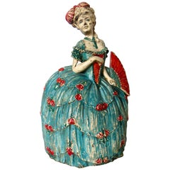 "Cast Iron Doorstop ""Woman in Hoop Skirt with Fan"" American, circa 1925"