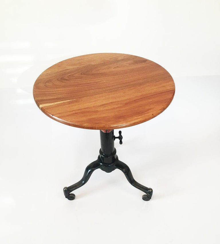 Mmanufactured by Adjustable Table Company Grand Rapids, Mich, U.S.A, circa 1920. Height adjustable, beautiful patina, smooth rolling casters solid and stable.