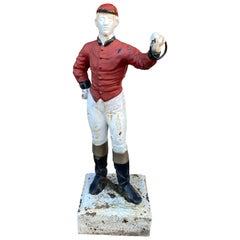 Cast Iron Lawn Jockey from the 1920s, in Red and White Paint