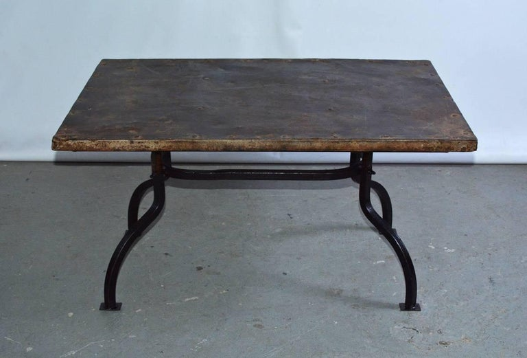 Rustic antique metal top on contemporary cast iron metal base coffee table. Wonderful patina.  Great to use indoor or outdoor on porch patio or garden.  Measures: Metal base - D 18