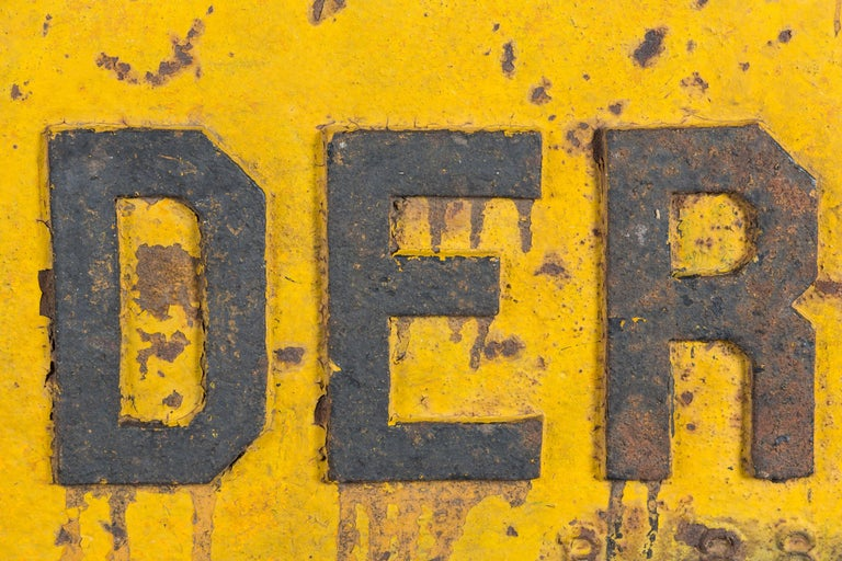 Very thick cast iron DERAIL sign, early 20th century American railroad. Great original yellow and black paint. Two holes for easy mounting. This sign is quite heavy.